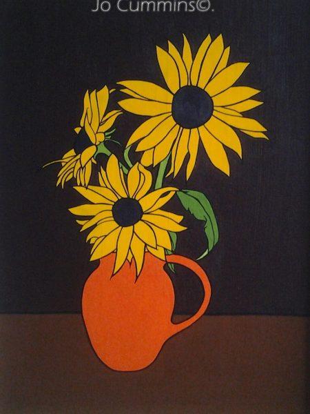 sun flower in orange jug